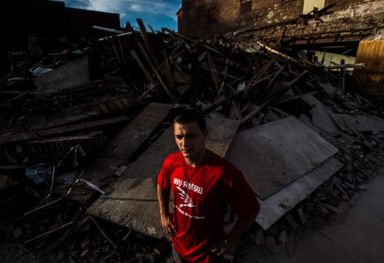 Hunter Nunes-Wales, a multi-sport Missisquoi star, looks over his former home, an apartment in the center of Swanton. The building was torn down earlier this summer but Hunter can still remember jumping from the roof onto the sidewalk to escape his biological father, who abused him and his siblings. Hunter was adopted by Johenry Nunes and Dave Wales in 2017, just before his 18th birthday.