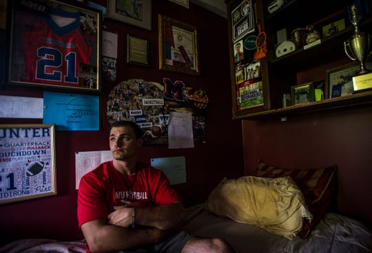 Hunter Nunes-Wales room is wall-to-wall sports. After suffering years of abuse at the hands of his biological father, Hunter was removed by the state and later adopted by Johenry Nunes and Dave Wales in 2017, just before his 18th birthday.