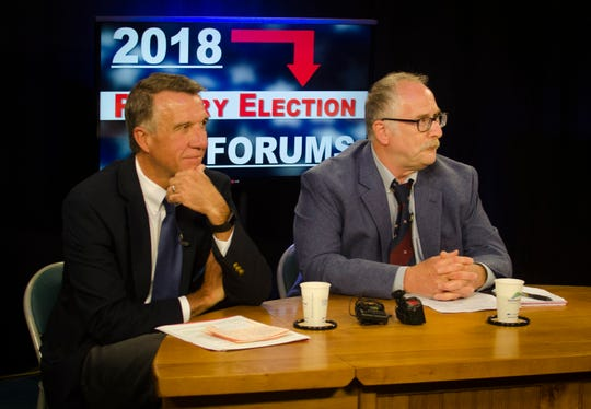 Gov. Phil Scott and his Republican primary opponent, Keith Stern, await the start of their first joint candidate forum at Channel 17/Town Meeting TV in Burlington on July 25, 2018.