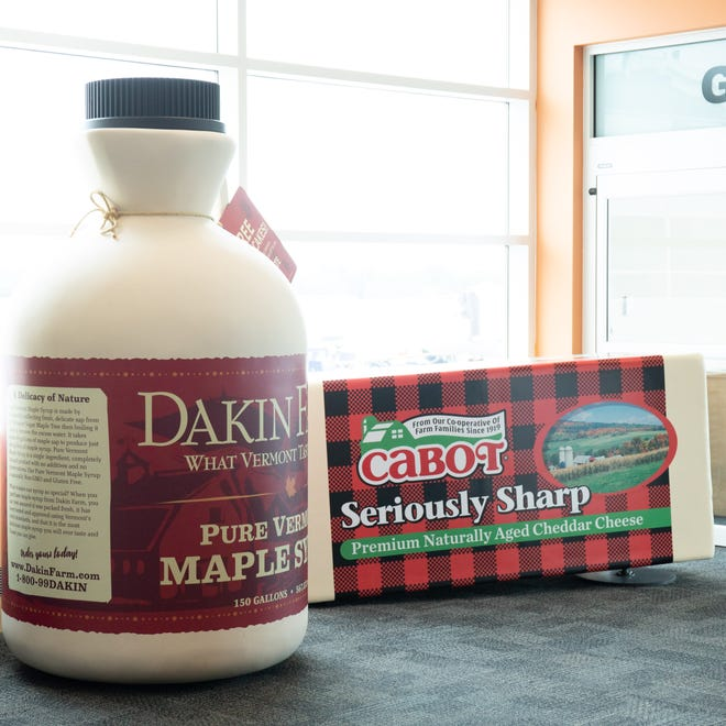 In each of Burlington International Airport's terminals are giant replicas of a maple syrup jug and a block of cheddar. Dakin Farm and Cabot Creamery are behind the 7-foot tall syrup jug and the 7-foot block of cheese. Seen here July 26, 2018.