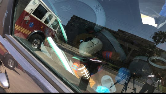 A stuffed animal and a thermometer record temperatures in a parked car outside Corpus Christi Fire Station #1 on Thursday, July 26, 2018.