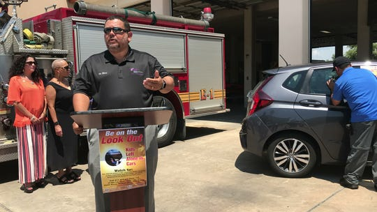 Dr. Osbert Blow, chief medical officer of Christus Spohn Hospital, talks about symptoms of heath exhaustion outside Corpus Christi Fire Station #1 on Thursday, July 26, 2018.