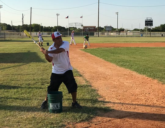 Oil Belt Junior League All-Stars coach Alejandro Perez hits during an infield drill on Wednesday, July 25, 2018 at Oil Belt Little League park. The Oil Belt Junior League team has qualified for the Southwest Regional Tournament in Albuquerque, N.M.