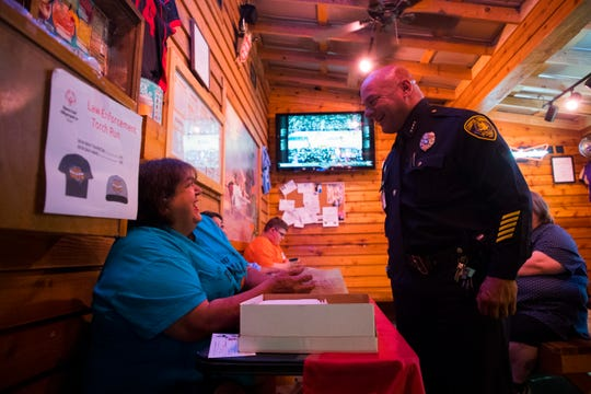 Police Chief  Mike Markle speaks Alice Fulton-Garza, Area Director of the Special Olympics, during the Tip a Cop event on Thursday, July 26, 2018, at Texas Roadhouse.