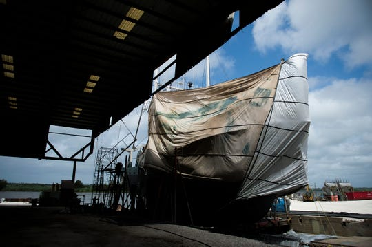 A scallop boat is wrapped in tarp as it undergoes maintenance Monday, July 23, 2018 at Dorchester Shipyard in Dorchester, N.J.