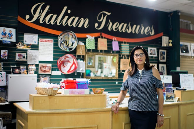 Celeste Cinalli poses in her Italian Treasures shop at Voorhees Town Center. Cinalli isn't ready to close the shop even as the mall falters.