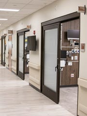 Instead of the use of curtains, sliding doors made of frosted glass will help ensure the privacy of the patients seen at the new Adena Regional Medical Center emergency department. In addition to the frosted glass, the glass doors help to reduce what is heard between a patience and doctor.