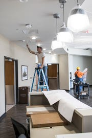 Construction workers paint and work on other small projects in the lobby of the new Adena Regional Medical Center emergency department for it to be ready to show.