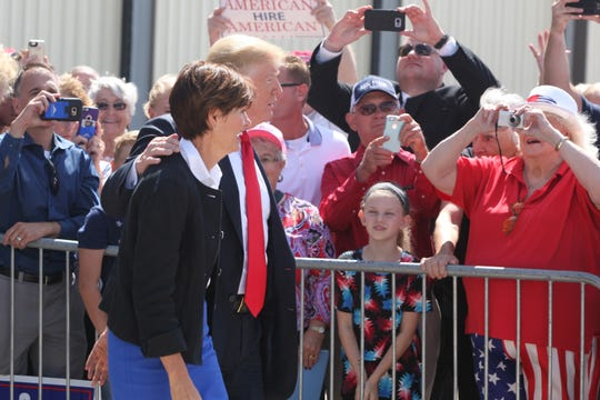 President Donald Trump and Gov. Kim Reynolds greet guests after arriving at Dubuque Regional Airport in Dubuque, IA on Thursday morning, July 26, 2018.