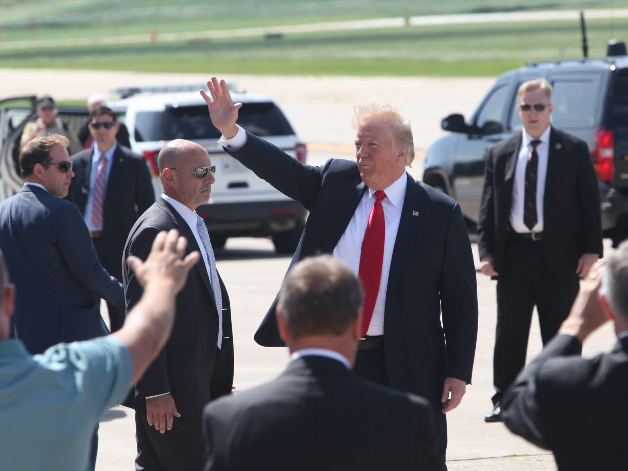 President Donald Trump greets guests after arriving at Dubuque Regional Airport in Dubuque, Iowa on Thursday morning, July 26, 2018. Trump will be visiting Northeast Iowa Community College to participate in a roundtable discussion about workforce development.