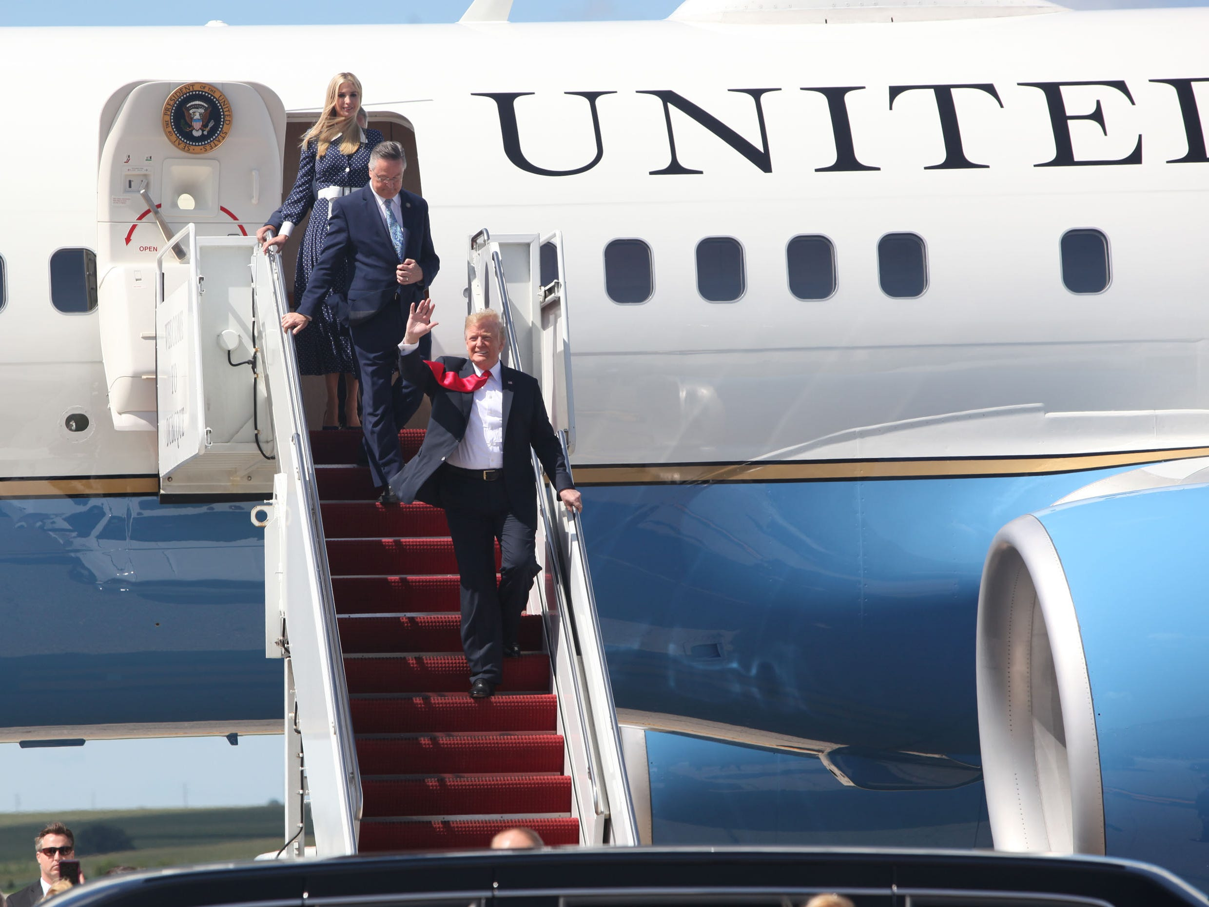President Donald Trump exits Airforce One followed by Congressman Rod Blum, R-Dubuque, and his daughter Ivanka Trump at Dubuque Regional Airport in Dubuque, IA on Thursday morning, July 26, 2018. Trump was in the state to participate in a roundtable discussion about workforce development at Northeast Iowa Community College in Peosta, Iowa.