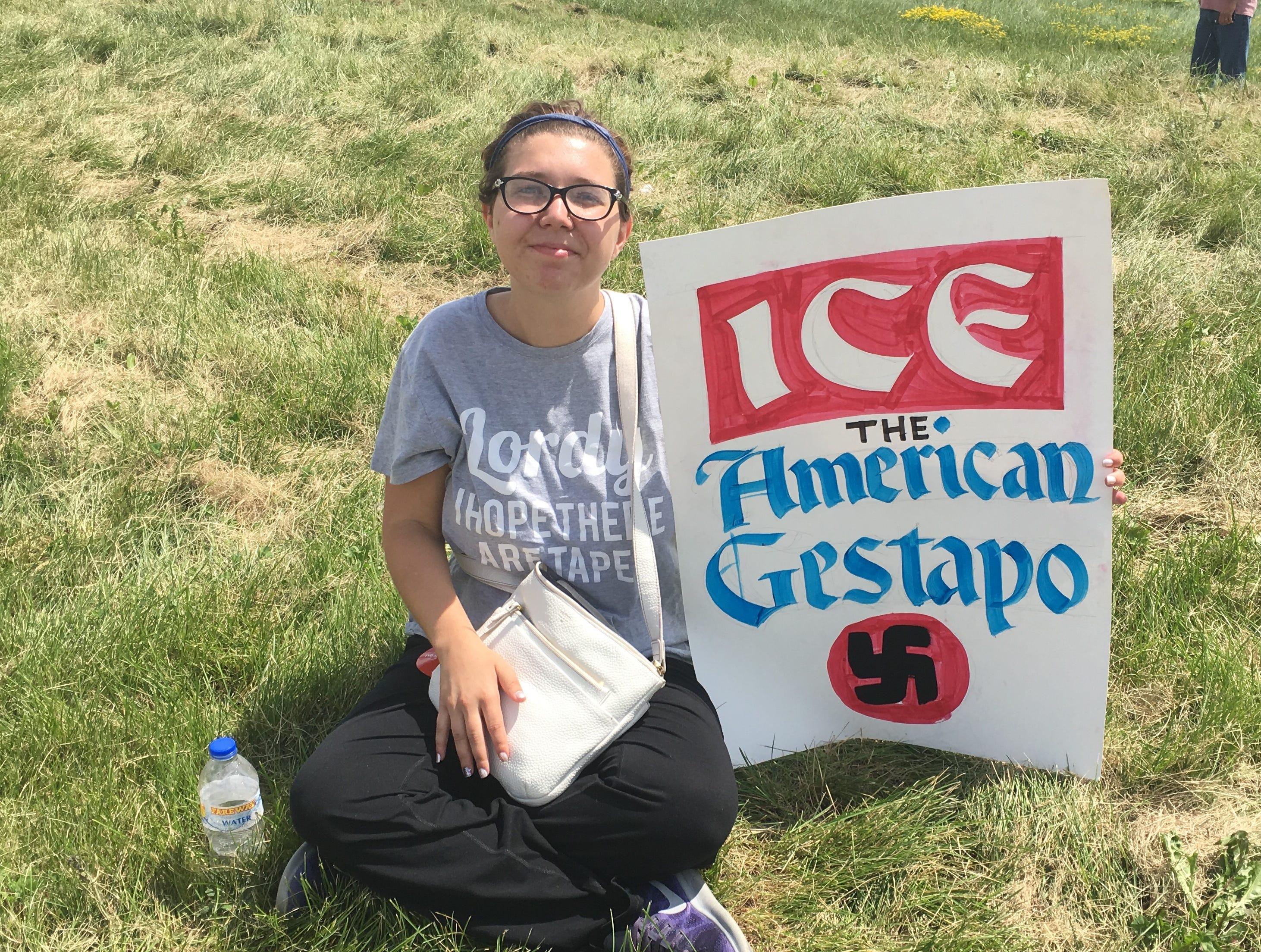 Rachel Greene, 23, of Cedar Rapids, came to Peosta to protest President Donald Trump Thursday, July 26, 2018.
