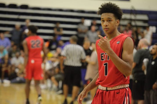 Iowa State point guard target Tre Mann communicates with a teammate at the Fab 48 in Las Vegas.