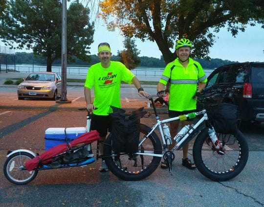 Steve Buser biked tailing his best friend Scott Mills' cargo while Mills, a three-time cancer survivor, ran across the state.