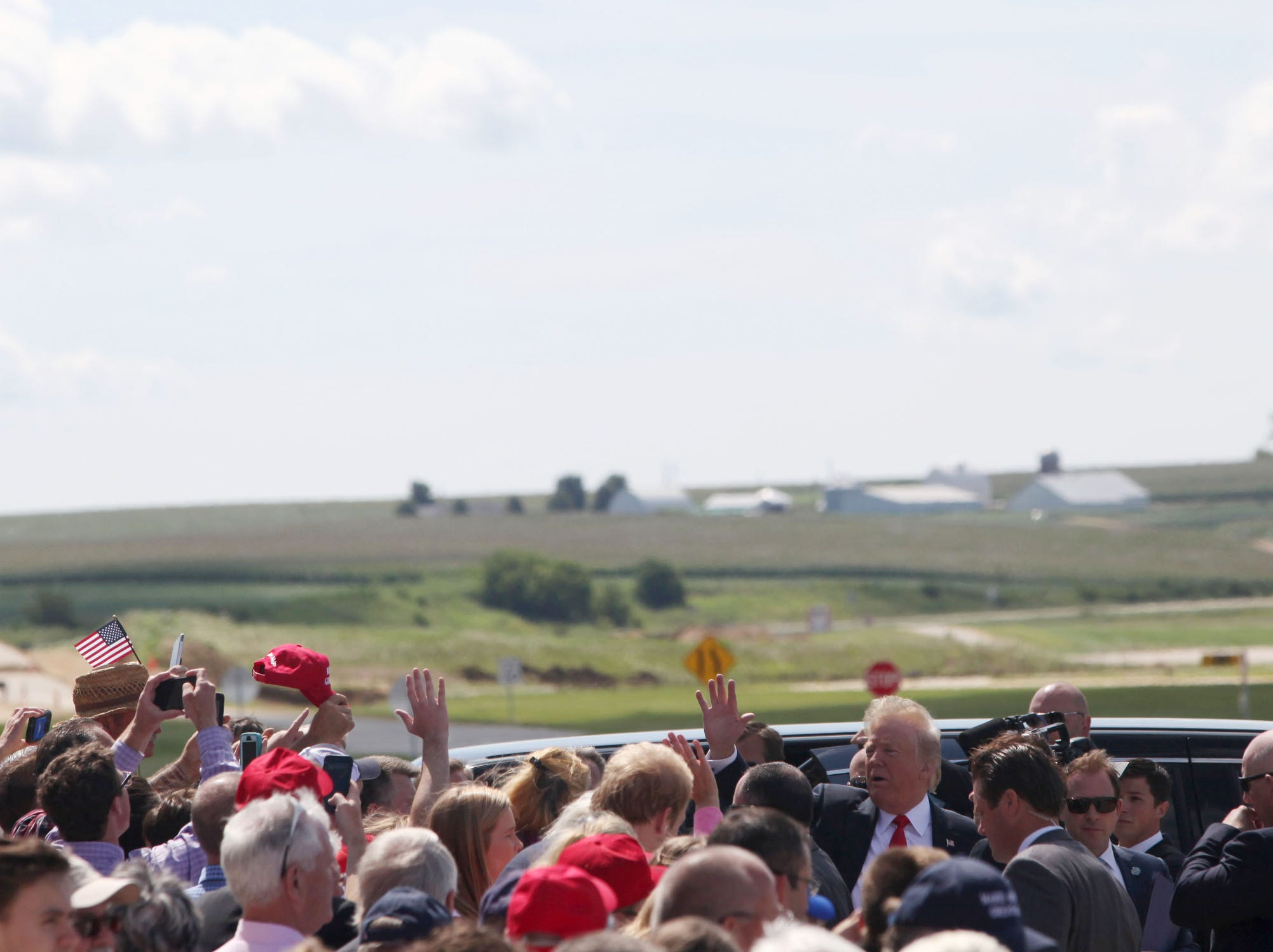 President Donald Trump greets guests after arriving at Dubuque Regional Airport in Dubuque, Iowa, on Thursday morning, July 26, 2018. Trump was in the state to participate in a roundtable discussion about workforce development at Northeast Iowa Community College in Peosta, Iowa.