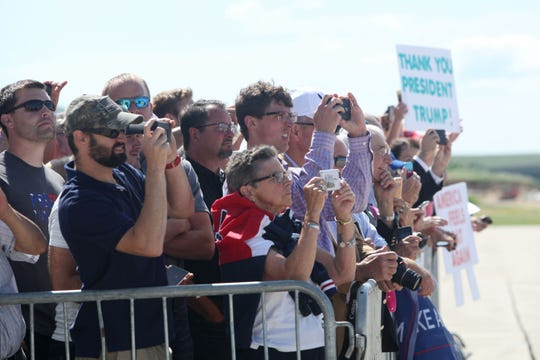 Supporters await President Donald Trump at Dubuque Regional Airport in Dubuque, Iowa, on Thursday morning, July 26, 2018. Trump was in the state to participate in a roundtable discussion about workforce development at Northeast Iowa Community College in Peosta, Iowa.