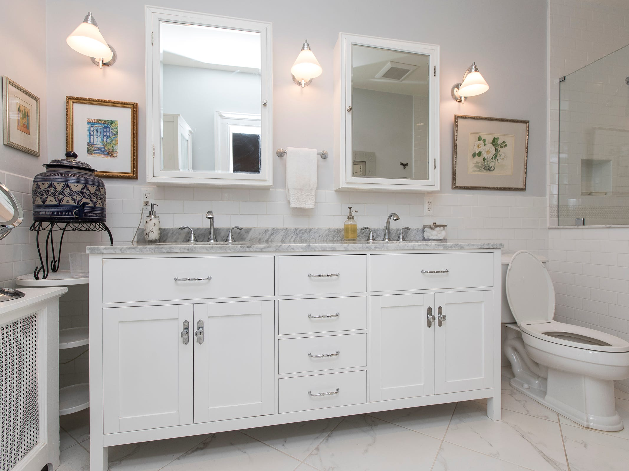 The owners' bath is one of only two spots where a wall was changed. The owner stole space from the back of a deep closet to enlarge the bath with a double-sink vanity and European shower.