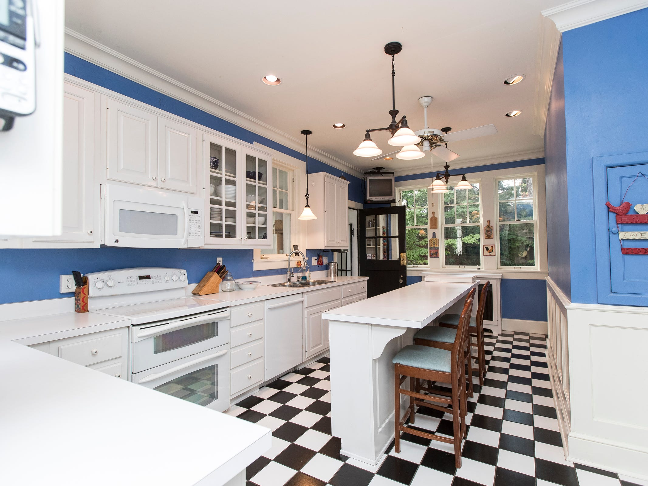 Appliances and cabinetry are new, but like most of the house, the long gallery kitchen retains its original layout.