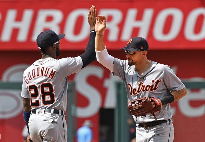 Detroit Tigers second baseman Niko Goodrum (28) and right fielder Nicholas Castellanos (9) celebrate after beating the Kansas City Royals at Kauffman Stadium on Wednesday, July 25, 2018.