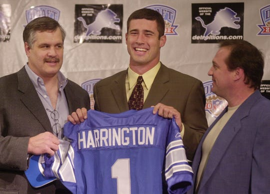 Lions president and chief executive officer Matt Millen, left, and coach Marty Mornhinweg, right, pose with the team's first-round draft pick, Oregon quarterback Joey Harrington, Sunday, April 21, 2002, at the Lions practice facility in Allen Park.