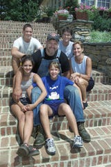 Lions president Matt Millen poses with his wife, Pat, right, and kids (clockwise from top left, Marcus, Matthew, Marianne and Michalyn) on the steps of their Pennsylvania home on July 11, 2001.