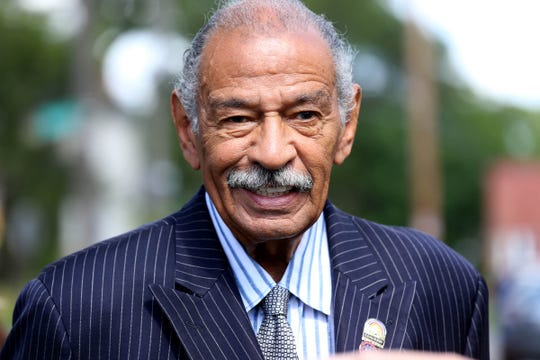 Congressman John Conyers  Jr. attends the Help us Grow Detroit event to unveil the Brush Street mural in Detroit's North End neighborhood on Thursday, August 14, 2014.