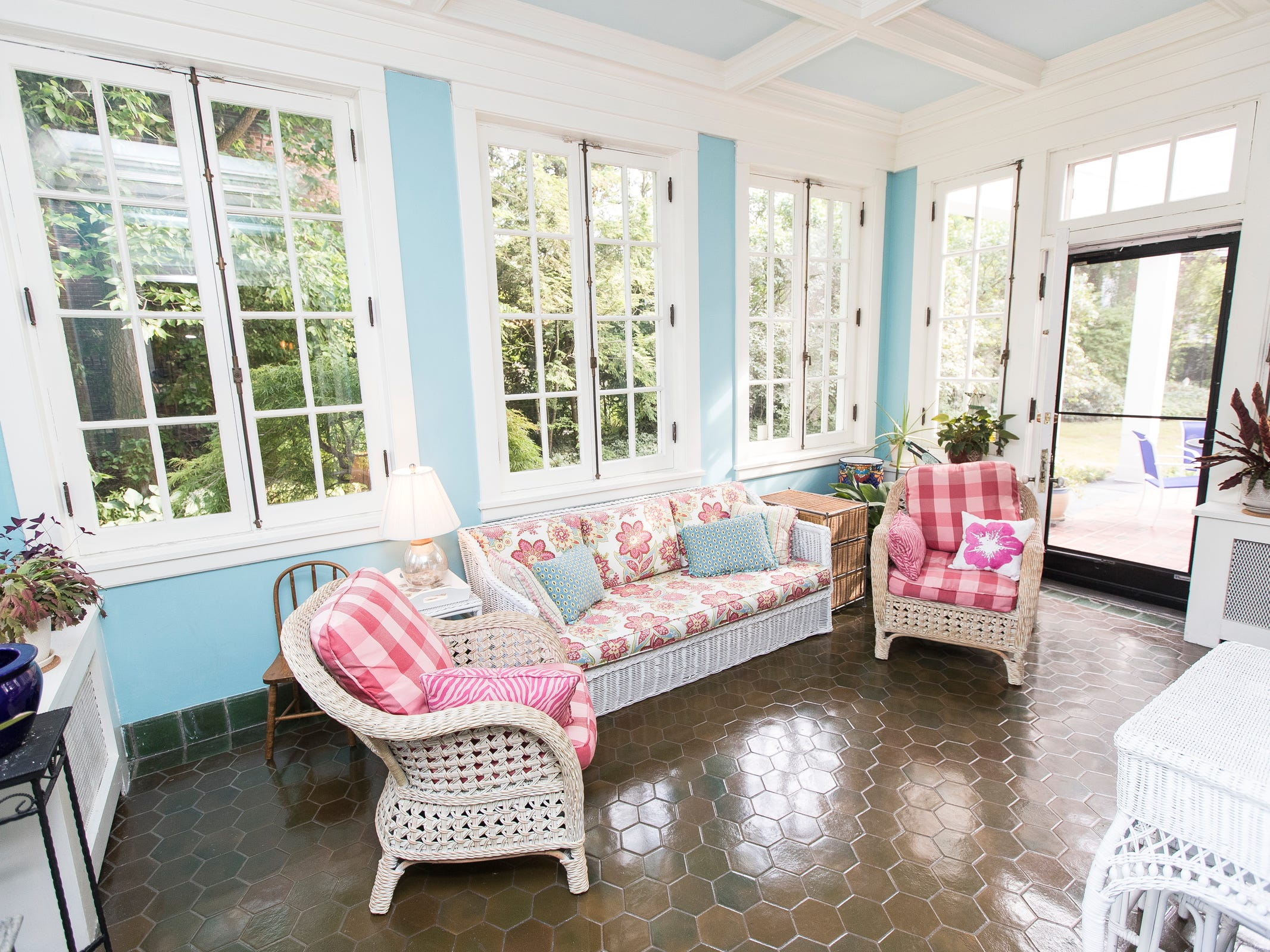 The aqua and white sunroom with a Pewabic tile floor.