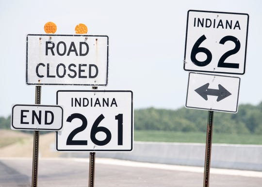 A road closed sign hangs over the new Boonville Bypass signs at the intersection of Indiana 261 and Indiana 62. The long-awaited bypass is set to open mid-August.