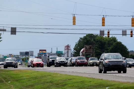 East-bound Lloyd Expressway traffic travels past the intersection of Burkhardt Road on the east side of Evansville, Ind., Thursday evening, July 26, 2018.
