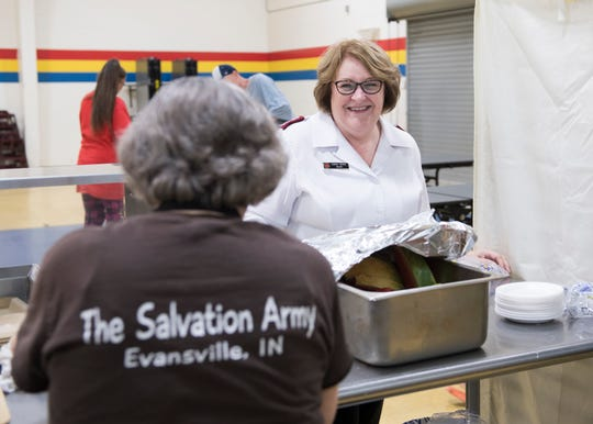 Salvation Army Major Sandi Turner chats with volunteer Rose Benton during lunch service on Thursday, July 26, 2018.