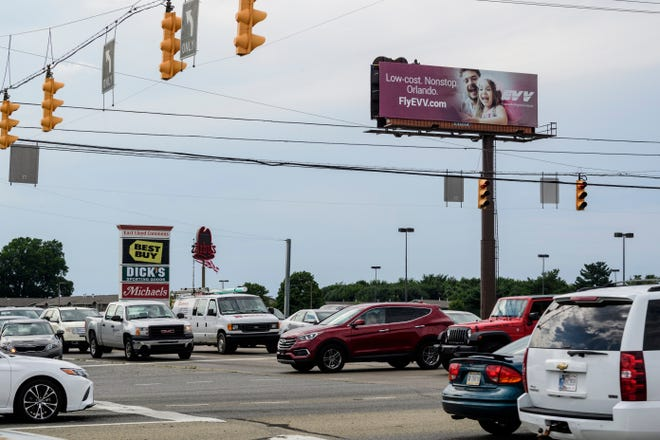 Traffic piles up at the intersection of Burkhardt Road and the Lloyd Expressway on the east side of Evansville, Ind., Thursday evening, July 26, 2018.