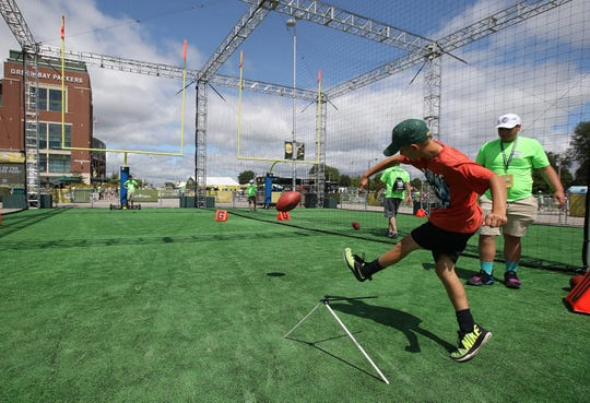Kyle LaRose of West Chicago, Illinois, kicks an extra point during the Green Bay Packers Fan Experience at Lambeau Field Thursday, July 26, 2018 in Green Bay, Wis.