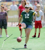 Amanda Boeckman tries her best to clear the crossbar in the Extra Point event during the Green Bay Packers Fan Experience at Lambeau Field Thursday, July 26, 2018 in Green Bay, Wis.