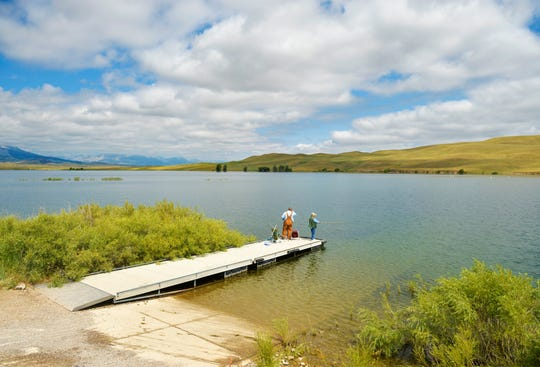 """Ole and Janice Allestad of Great Falls fish for trout at Nilan Reservoir Wednesday. """"This is the first time I've ever heard of it,"""" Ole said of signs warning of harmful blue-green algae."""
