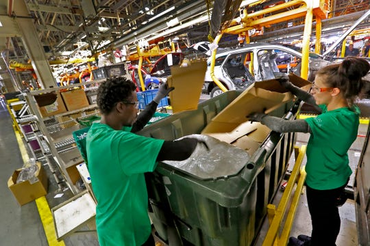 Avery Gray and Britny Sears break down boxes at Subaru Indiana Automotive. in Lafayette, Thursday, July 25, 2018.  The Indiana plant is the first automaker in North America to go zero landfill, meaning the plant with 5600 employees that produces 350,000 cars a year sends nothing to a landfill.