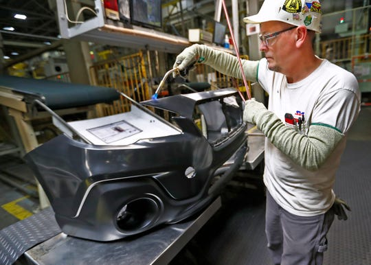 Terry Millikan takes bumpers off the line at Subaru Indiana Automotive. in Lafayette, Thursday, July 25, 2018.  Scrap and defective bumpers are ground up, and the reground plastic is added back into the bumper injection molding machine to create new bumpers. The reground plastic is mixed with a specific amount of virgin polymer to keep the original properties of the plastic resin.  The Indiana plant is the first automaker in North America to go zero landfill, meaning the plant with 5600 employees that produces 350,000 cars a year sends nothing to a landfill.