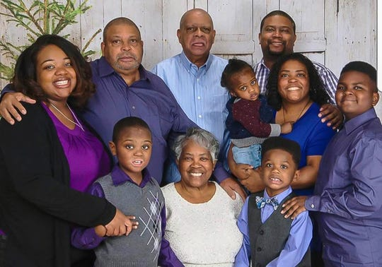Tia Coleman, far left, and her 13-year-old nephew, Donovan, far right, survived the Missouri boat accident July 19, 2018. The Coleman family members who died were, clockwise from top left, Horace, Irvin, Glenn, Angela, 2-year-old Maxwell, 7-year-old Evan, Belinda, and 9-year-old Reece. Arya, 1, not shown, also died.