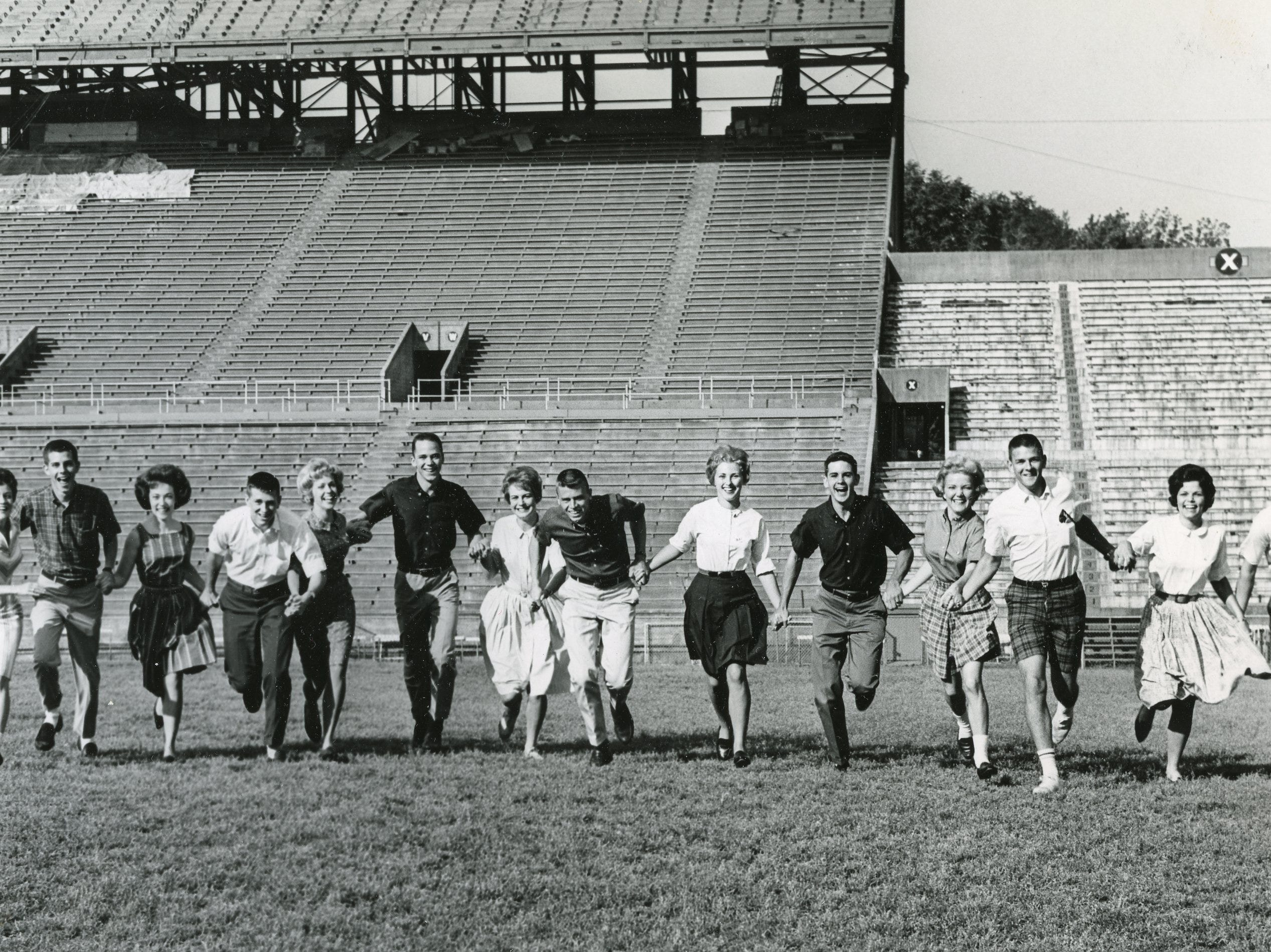 Cheerleaders at UT, 1962, included Linda May, Terry Smith, Sandra Duncan, Peter VonElton, Sally Plunkett, Chuck Dyche, Janet Stanford, Larry McMahon, Wallene Threadgill, Charlie Baker, Sue Novotny, Jim Bankston, Elisabeth Shafer and Tommy Leak.