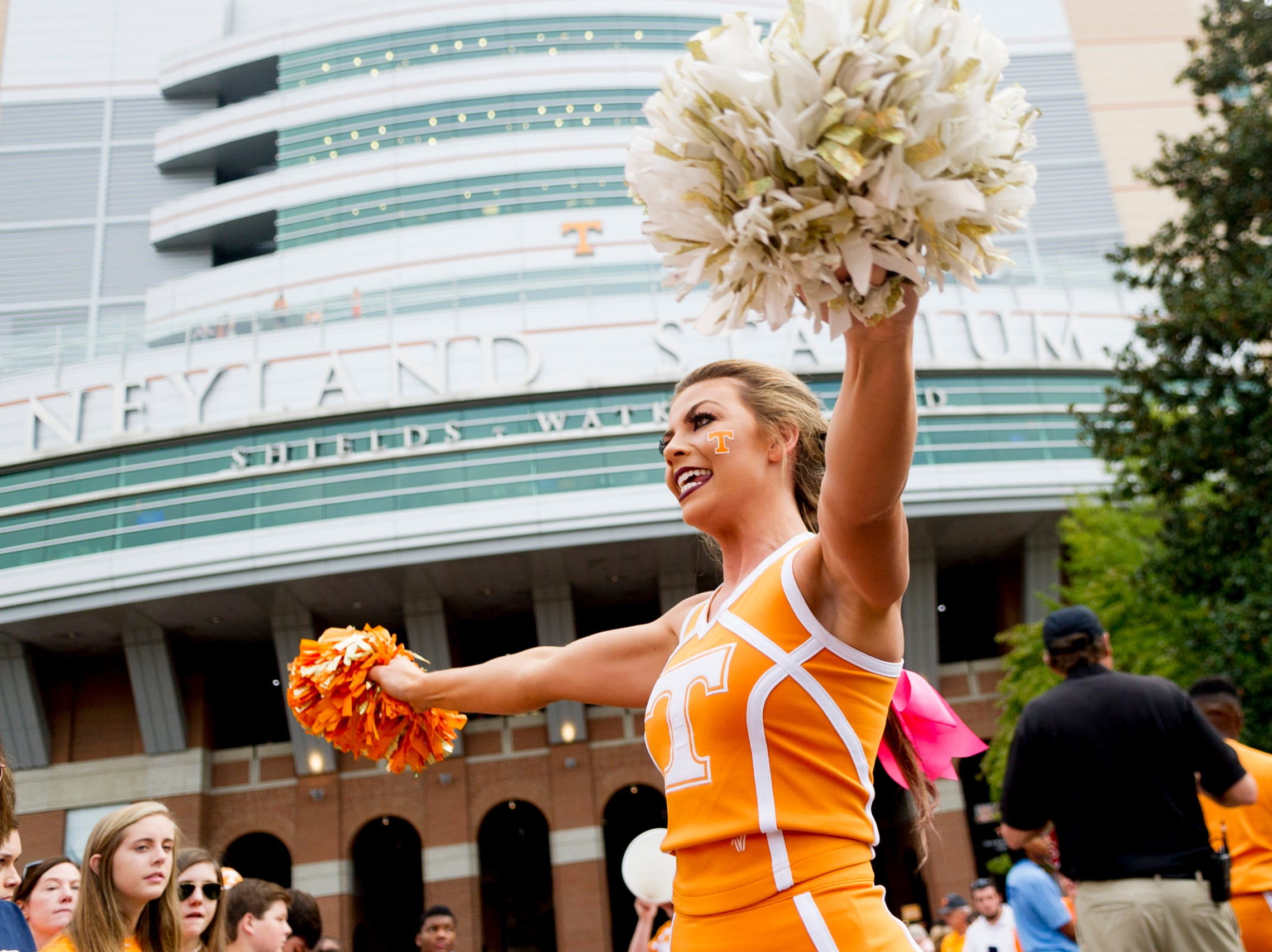 A Tennessee cheerleaders pumps up fans during the Vol Walk during the Tennessee Volunteers vs South Carolina Gamecocks game at Neyland Stadium in Knoxville, Tennessee on Saturday, October 14, 2017.