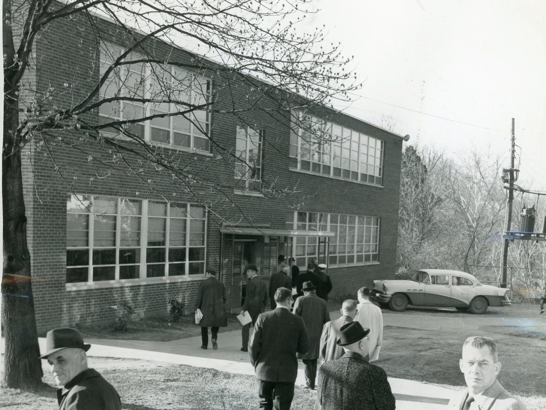Councilmen, city and school officials take a Saturday tour of Young High School, January, 1964.