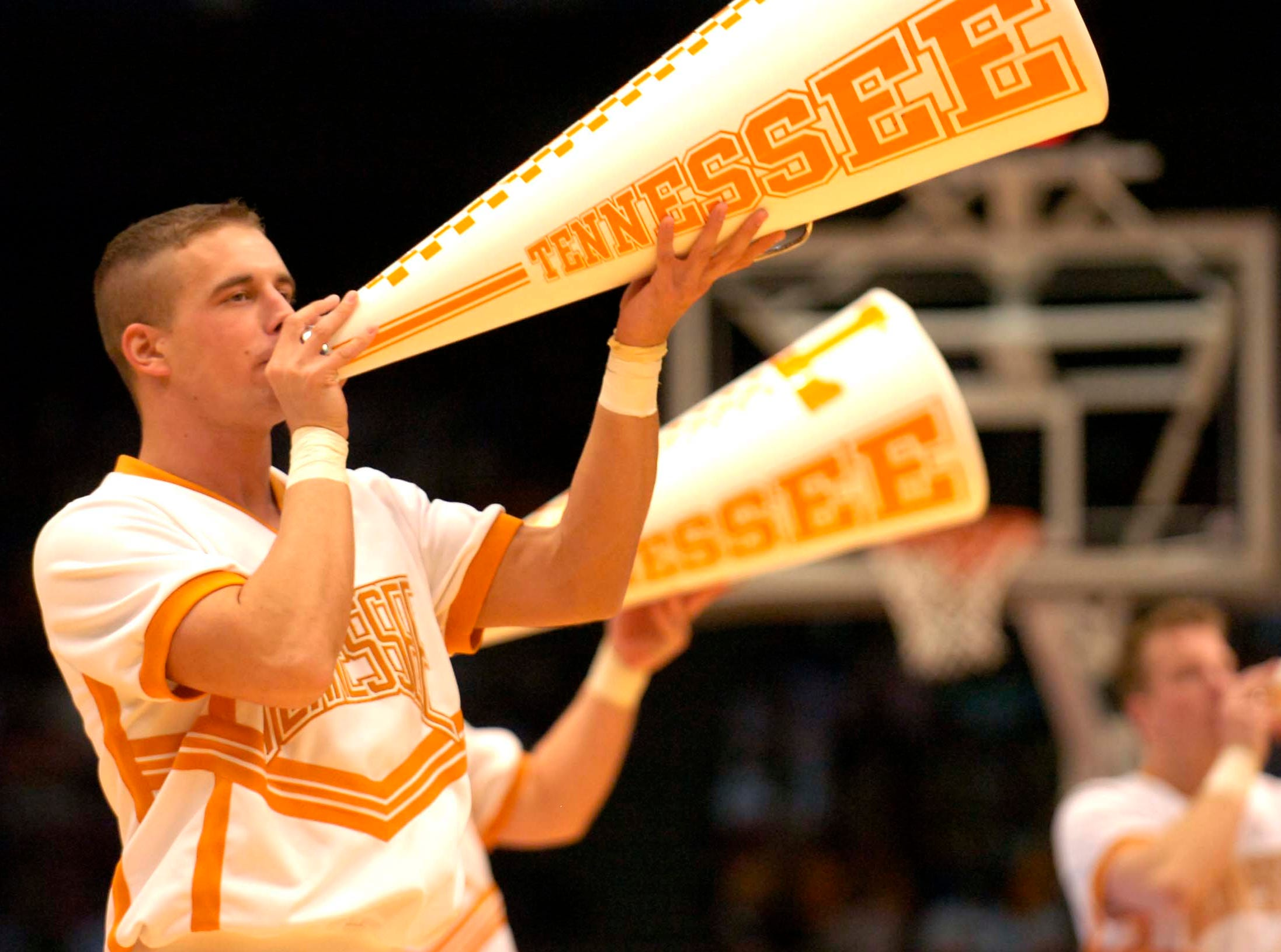 A Tennessee cheerleader tries to get the crowd involved during a timeout at the Birmingham Jefferson Convention Center in Birmingham, Alabama during second round play in the NCAA Tournament on Sunday. Tennessee defeated Butler 76-71 and will advance to the Sweet Sixteen in Charlotte, NC next week.