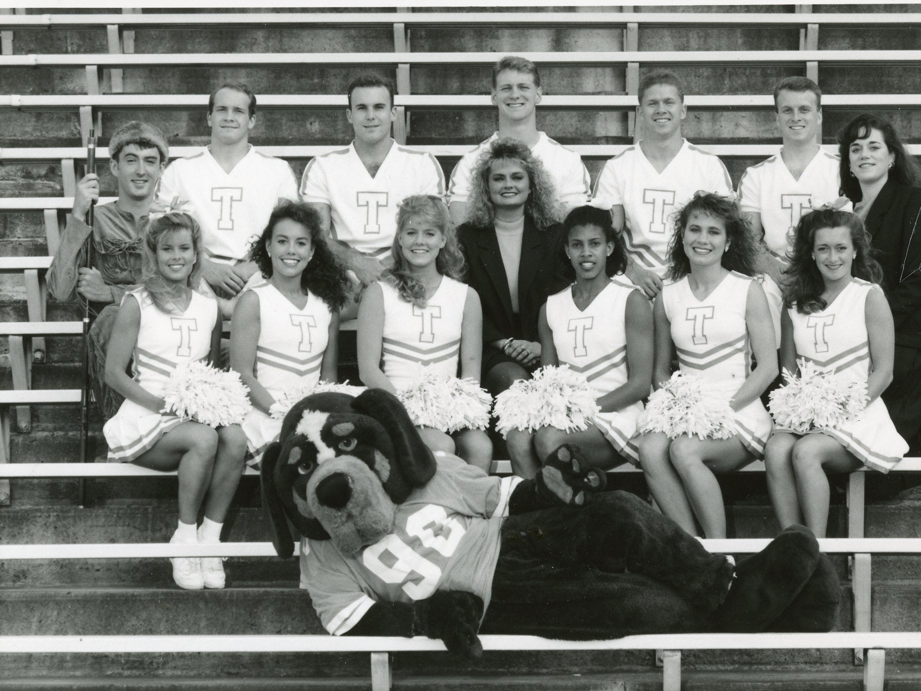 University of Tennessee, 1993 cheer team. Smokey, Christopher Broyles; (first row) Pam Peters, Andra Cureton, Keleah Sturdivant, Jennifer McGee, Gloria Blevins, Kyla Parker; (second row) the Volunteer Jeff Cathey, coach Joy Postell, Susie Gorman, spirit coordinator; (third row) Kirk Graves, Simuel Howell, Paul Cox, Gabe Hannah, Stephen Davis. Not pictured are Joel Gragale, Brock Lodge and Weston O'Dell.
