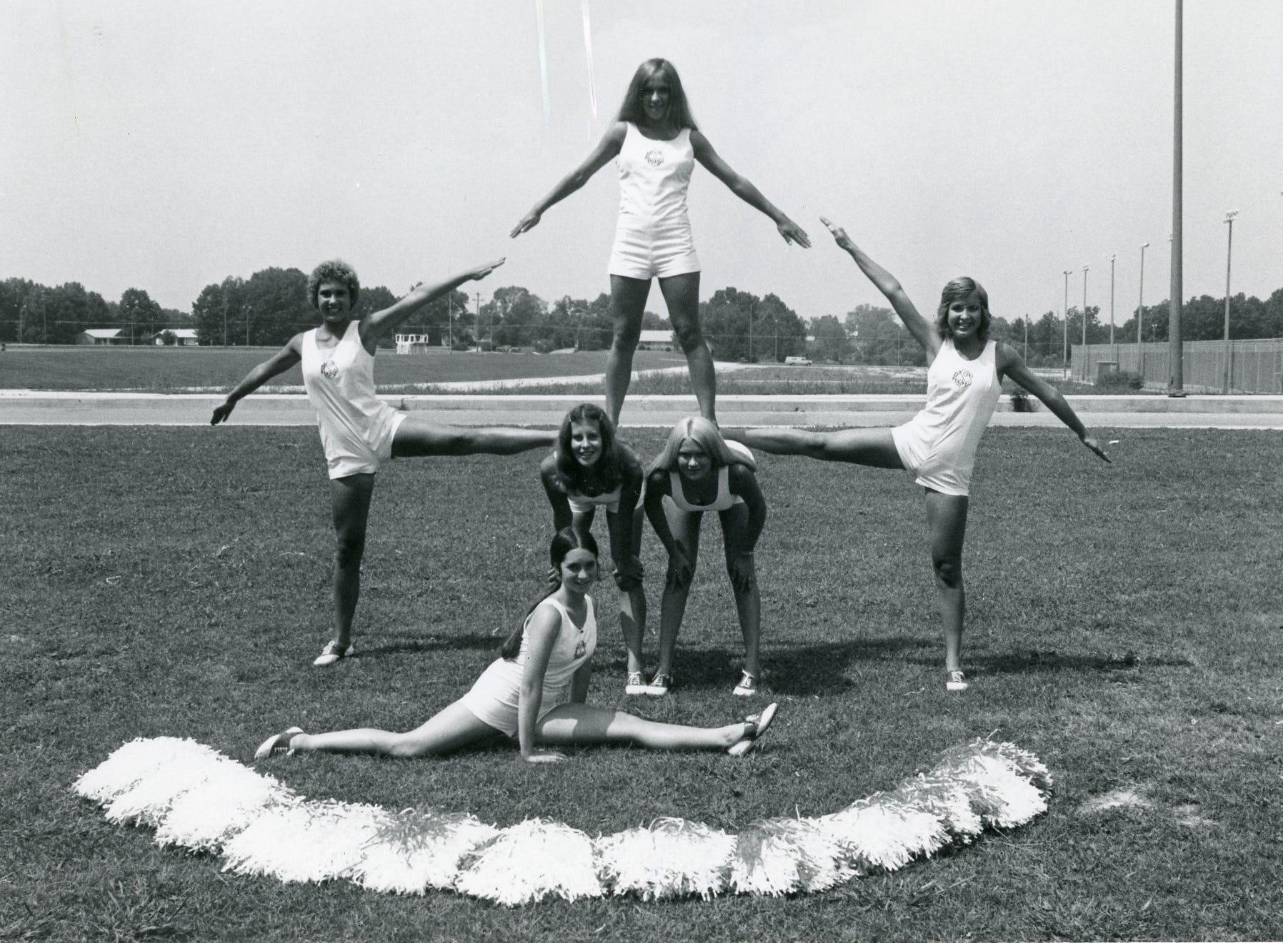 """South High """"B team"""" cheerleaders (front) Cheryl Bird; (middle) Amy Cowart, Karen Meadows, Lisa Gibbs, Diane Dennis; (top) Lynne Edmonds."""
