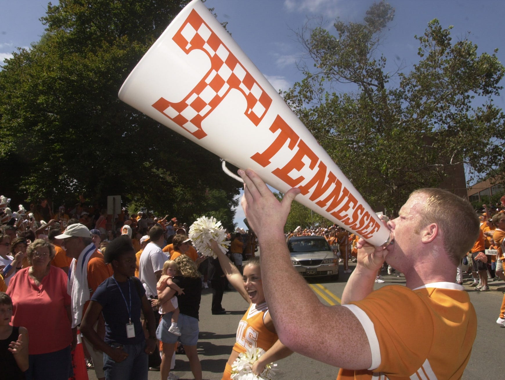 University of Tennessee cheerleaders Joel Rogers and Melea Shatley get the crowd pumped up before the players make the Vol Walk to the stadium for Tennessee's home-opening game.
