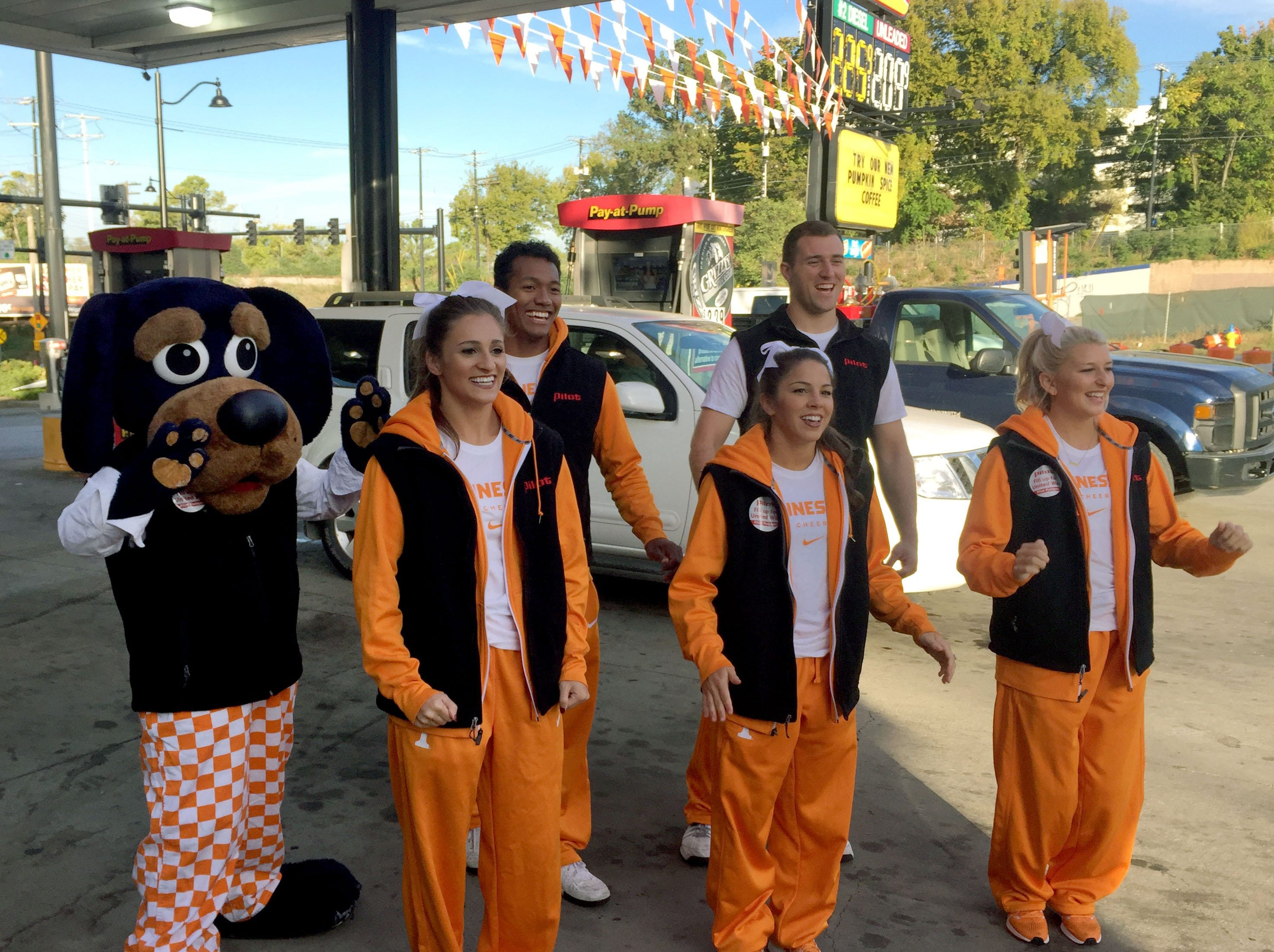 The University of Tennessee Spirit Team was at the Cumberland Ave location as celebrity pumpers to raise money for United Way Tuesday, Oct. 11, 2016.