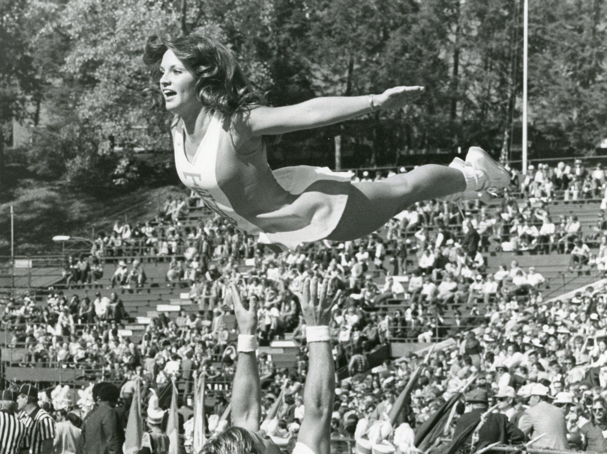UT cheerleader Cindy Greene flies high, November, 1975.
