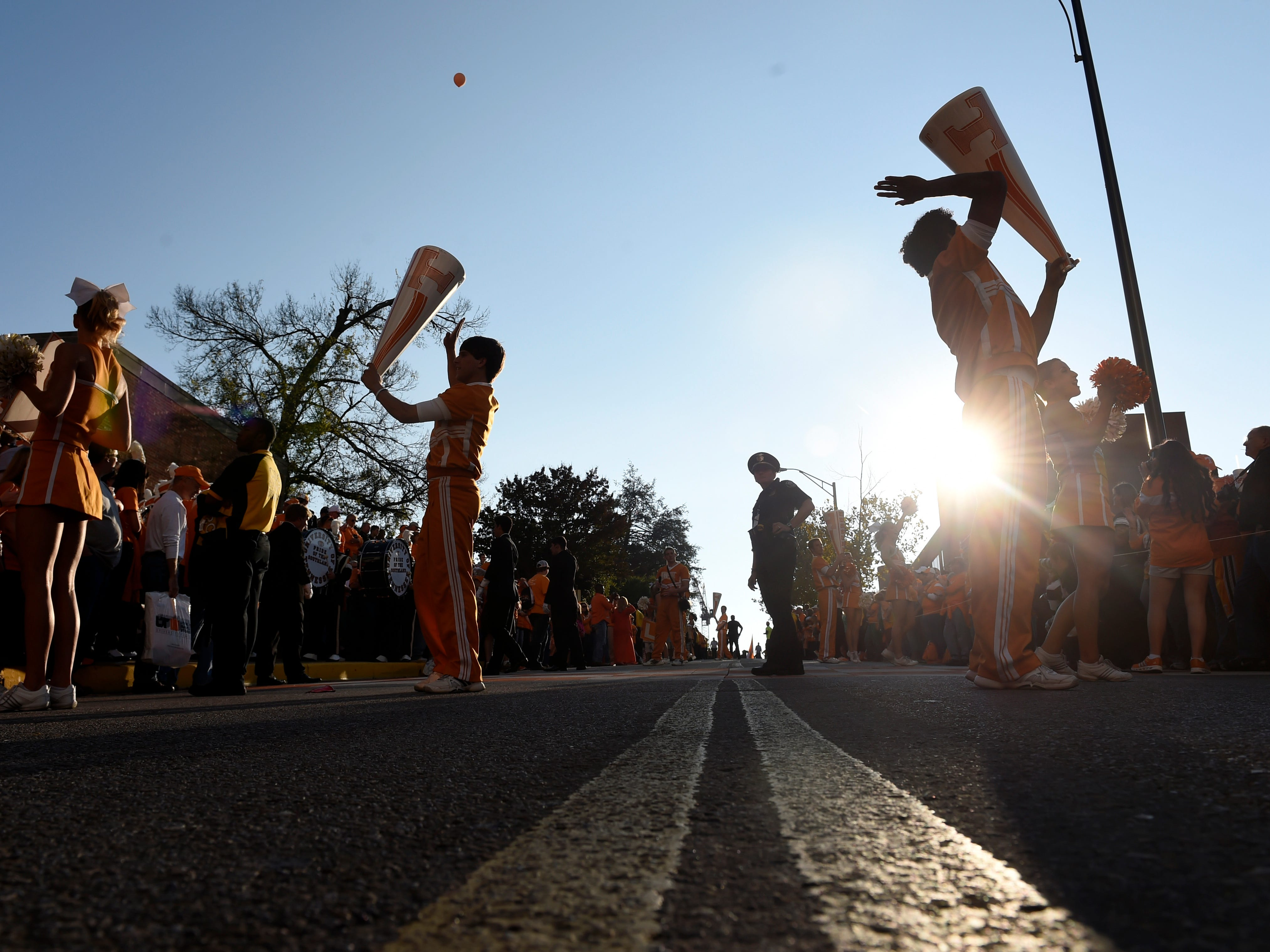 Tennessee cheerleaders pump up the crowd prior to the Vol Walk before their game against Alabama at Neyland Stadium in Knoxville, Tenn., Saturday, Oct. 25, 2014.