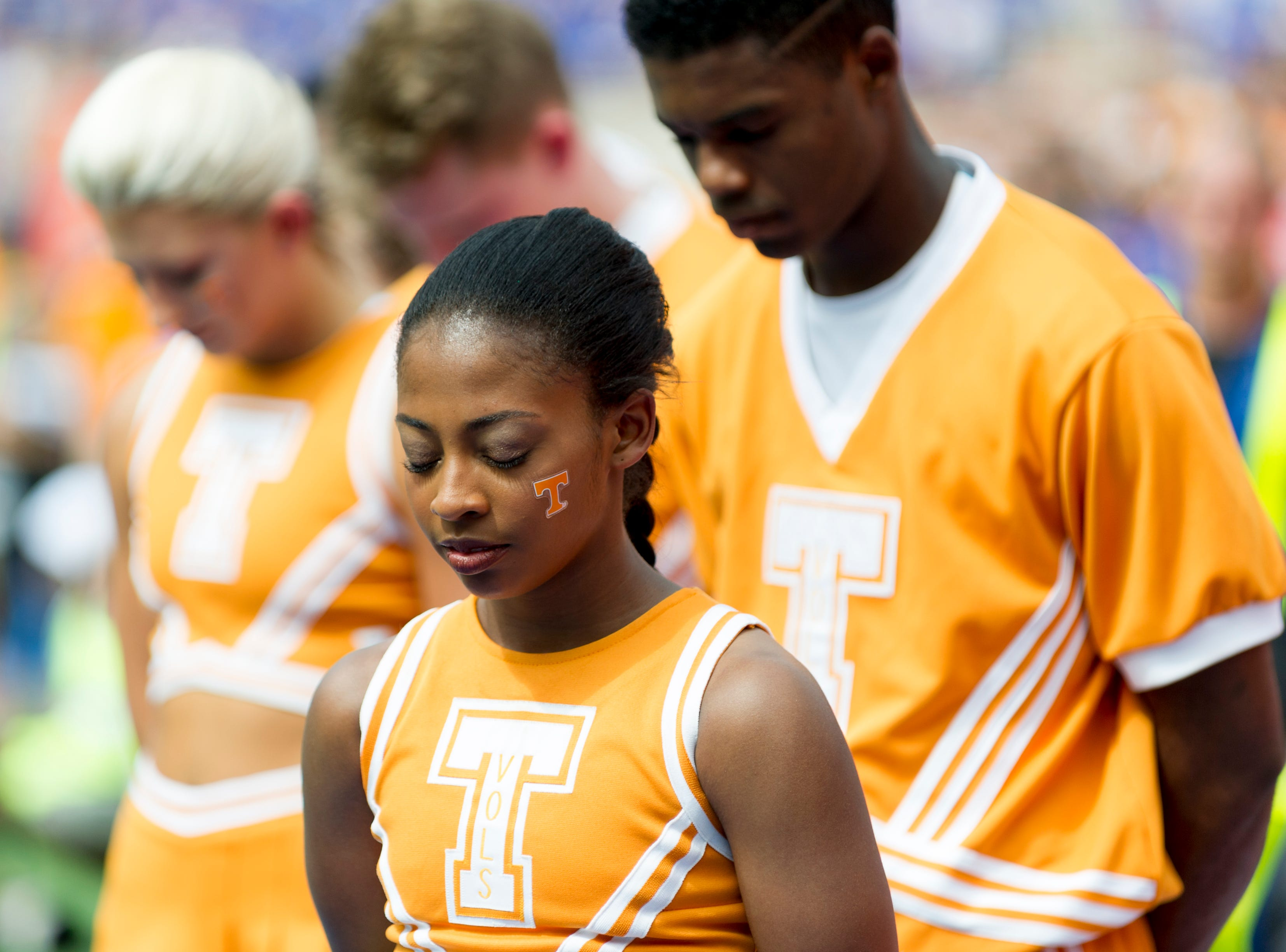 Tennessee cheerleaders have a moment of silence before the game during the Tennessee Volunteers vs. Florida Gators game at Ben Hill Griffin Stadium in Gainesville, Florida on Saturday, September 16, 2017.