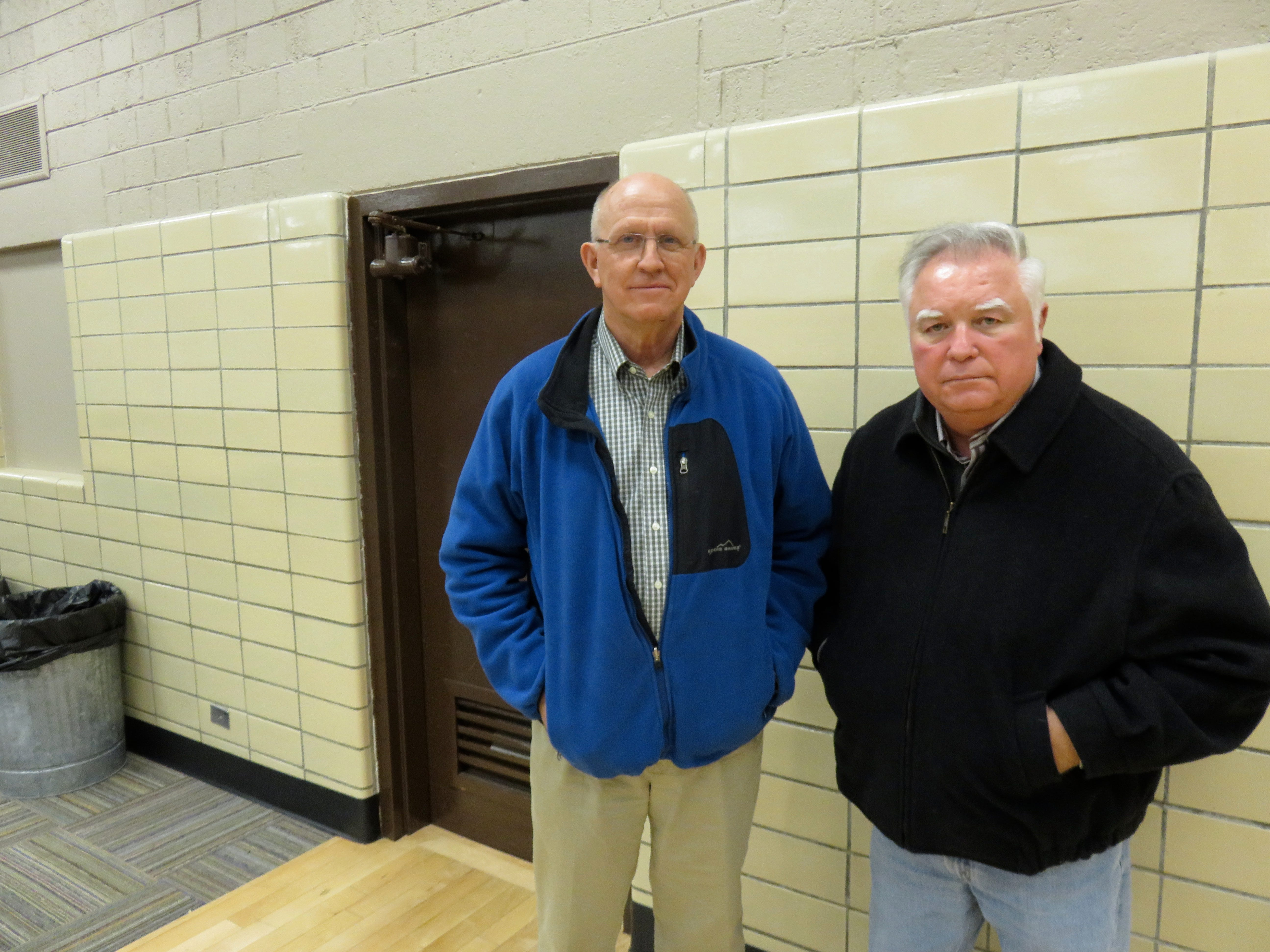 South High School graduates Bill Young, left, and Jack Jones are pictured at their old school. They played in the first Knoxville high school basketball game between all-white and all-black teams when South hosted Austin High School on Nov. 21, 1964.