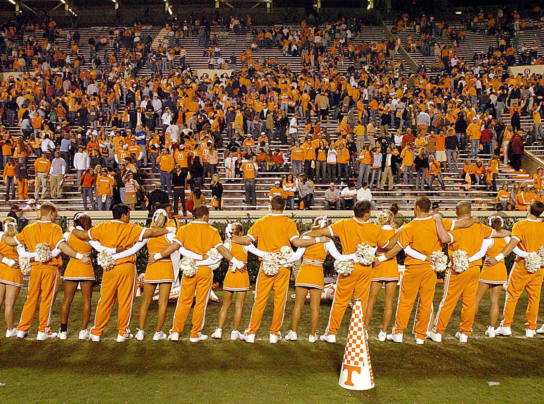 University of Tennessee cheerleaders sway to the school song at the conclusion of the game Saturday night at Neyland Stadium.   11/6/2004